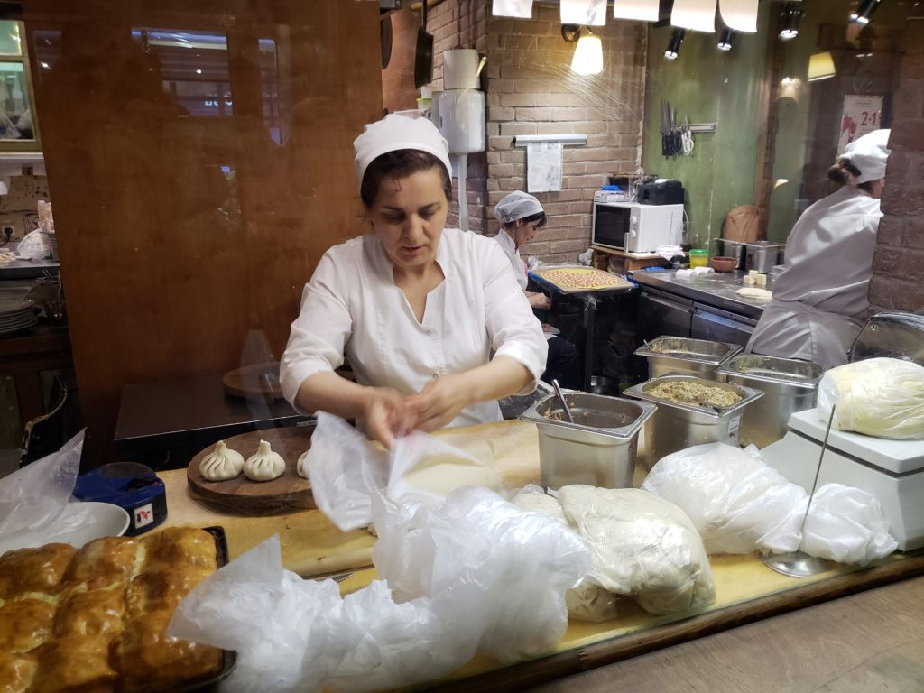 lady making pelmeni dumplings in Russia