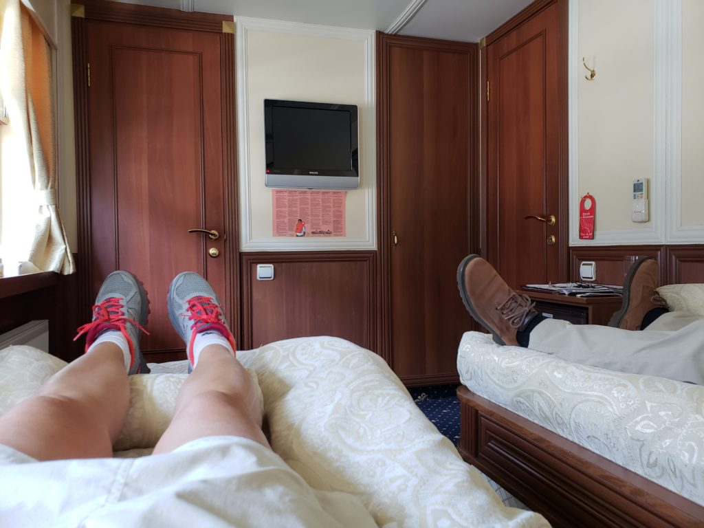 laying on bed in stateroom